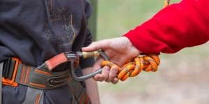 Clipping caribiner to harness at Camp Toolangi